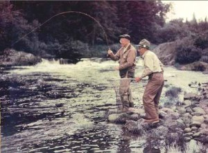 "Eisenhower fishing ""little boy falls"" in 1955 in Maine."