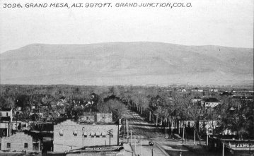 Grand Junction back in the day with the Grand Mesa in background