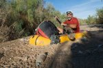 Jonathan Waterman paddling the ooze in the Colorado River Delta via National Geographic