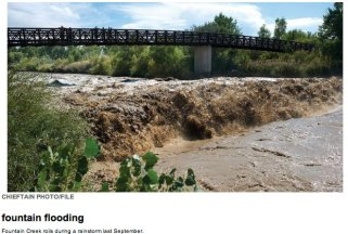 Fountain Creek swollen by stormwater in 2011 -- photo via The Pueblo Chieftain