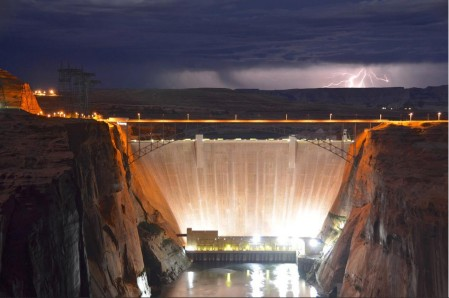 A high desert thunderstorm lights up the sky behind Glen Canyon Dam -- Photo USBR