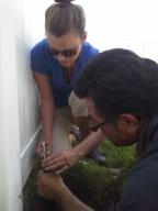 Conservation technicians Jenelle Rhodes and Rick Alvarado adjust a sprinkler head during an irrigation audit.