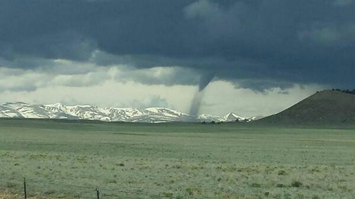 Taken just east/north of Hartsel around 11am June 8, 2014 by Laura Rhodes.  Snow capped mountains and tornado -- Brian Bledsoe