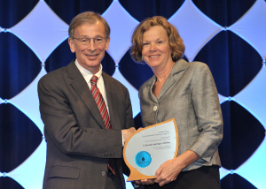 Ann Seymour, Colorado Springs Utilities' water conservation manager, receives the award Oct. 9, 2014