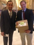 CWCB director James Eklund with manager in Water Supply Planning, Jacob Bornstein bring  a box containing the draft water plan to the Capitol.