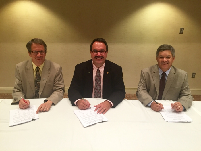RRCA resolution signing August 27, 2015. From left to right: David Barfield, Dick Wolfe and Jeff Fassett(Photo courtesy RRCA)