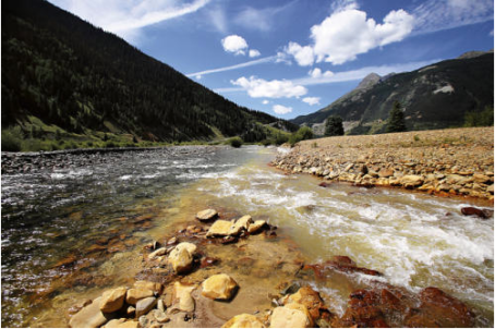 The confluence of Cement Creek, at right, and the Animas River, left, as seen September 2015 in Silverton, Colo. This is where the plume of contaminated water from the Gold King Mine entered the Animas River. (Jon Austria — The Daily Times)