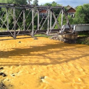 The Animas flows orange through Durango on Aug. 7, 2015, two days after the Gold King Mine spill. (Photo via www.terraprojectdiaries.com)
