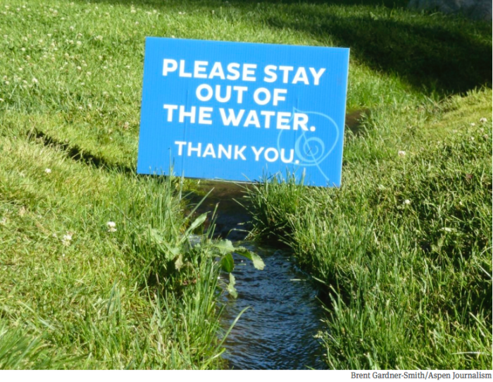 This sign, on the irrigated lawn outside the Aspen music tent, could well sum up how Front Range and Western Slope water organizations view each other.