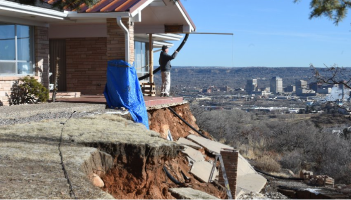(Screen shot) Five years ago, Rick Sisco and his wife bought their home on Constellation Dr. in the Skyway area. Since last Summer, the home for the Siscos is being threatened by the eroding hillside and a fifteen foot cliff has formed in his front yard. Rick Sisco looks over the view that sold them on the house on Thursday, January 28, 2016. Photo by Jerilee Bennett/The Gazette