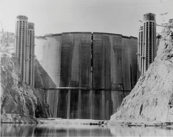 Back of Hoover Dam prior to first fill photo via Reclamation.