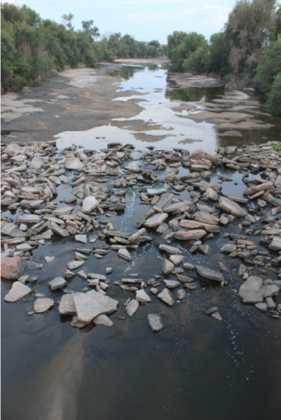The South Platte River typically all but vanishes as it passes through Denver's industrial neighborhood north of downtown, downstream of the Burlington Ditch diversion, near the Cherokee power plant. Photo/Allen Best