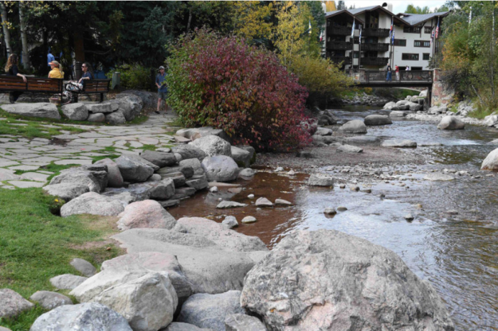 Streets and other artificial impervious areas result in rapid runoff of pollutants into the creek. Photo via The Mountain Town News and Jack Affleck.