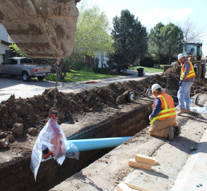 Denver Water crew installs a new 12-inch-diameter pipe as part of 2015 pipe replacement program in southeast Denver neighborhood.
