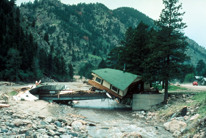 Big Thompson Flood, Colorado. Cabin lodged on a private bridge just below Drake, looking upstream. Photo by W. R. Hansen, August 13, 1976. Photo via the USGS.