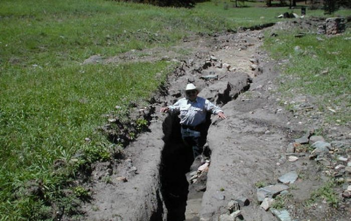 """This picture is an example of a head cut on another stream (Image courtesy of the <a href=""""https://www.env.nm.gov/swqb/Wildfire/Viveash/index.html"""">New Mexico Environment Dept.</a>) and Western Resource Advocates."""