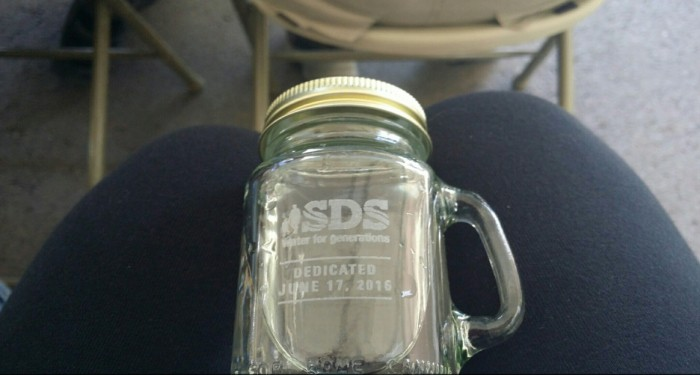 All that was left at the end of 75 minutes of speeches was to have a sip of SDS water. Photo via the Colorado Springs Independent.