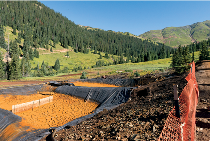 Diverting mine drainage into settling ponds allows iron oxides, heavy metals and other suspended particles to precipitate. Credit: EPA.