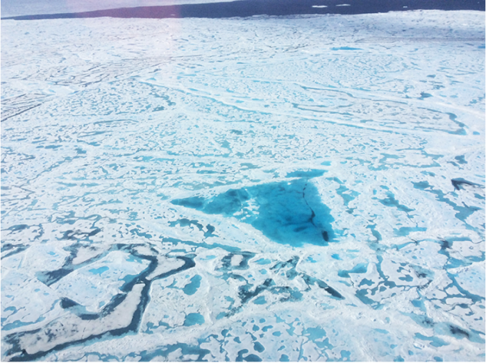 A large pool of melt water over sea ice, as seen from an Operation IceBridge flight over the Beaufort Sea on July 14, 2016. During this summer campaign, IceBridge will map the extent, frequency and depth of melt ponds like these to help scientists forecast the Arctic sea ice yearly minimum extent in September. Credit: NASA/Operation IceBridge.