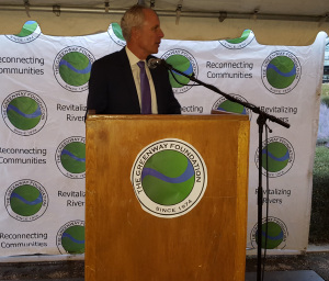 Denver Water CEO Jim Lochhead announces a pledge drive for storage space in the Chatfield environmental pool at a Greenway Foundation event.