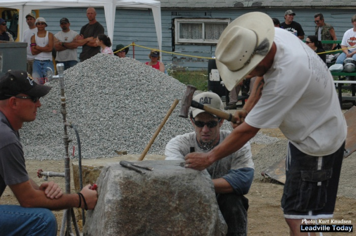 In the hand-steeling event, one man uses a four-pound hammer to drive a three-quarter inch diameter steel into rock. Leadville Boom Days Mining events are held Saturday & Sunday in the Elks parking lot. Photo: Kurt Knudsen/Leadville Today