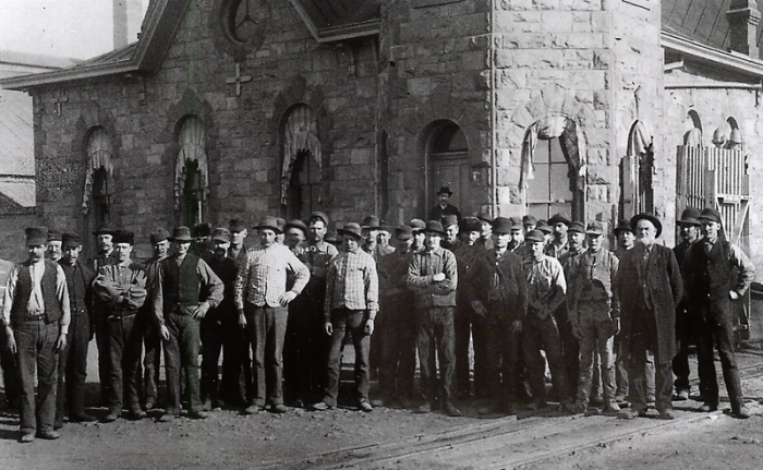 Workers pose in front of the Boston and Colorado Smelter at Argo Photo Colorado Historical Society