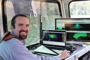 Jason Ellis, survey senior tech, conduct bathymetric survey on Cheesman Reservoir.