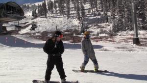 Snowboarders at Arapahoe Basin