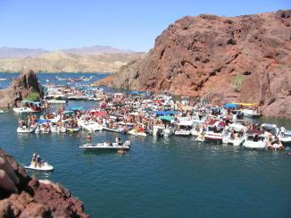 Lake Havasu is a large reservoir behind Parker Dam on the Colorado River, on the border between California and Arizona. Lake Havasu City sits on the lake's eastern shore. Photo credit MyGola.com