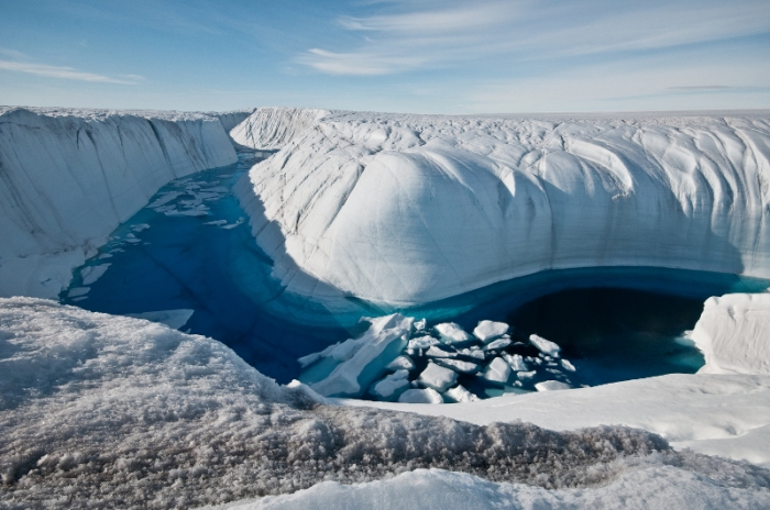 Greenland ice canyon filled with melt water in summer 2010.Ian Joughin, UW APL Polar Science Center