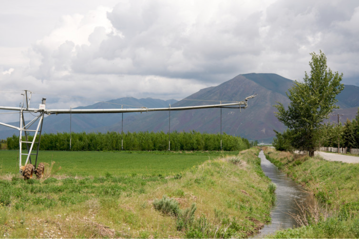 Irrigation ditch and sprinkler, Silver Creek, Idaho.  Sam Beebe/Flickr, CC BY