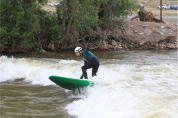 A standup surfer in the Arkansas River at Salida during Fibark, the river celebration held in late June. Photo/Allen Best