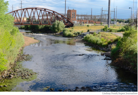 The South Platte River runs by a utility plant near I-25 in Denver.