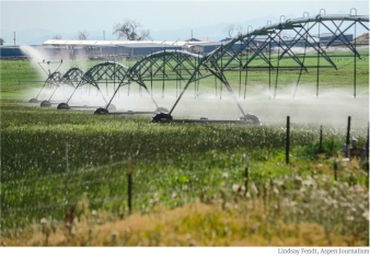 Irrigation sprinklers run over a farm in Longmont in the South Platte River basin. One goal of an emerging storage project on the South Platte is make it easier to temporarily use water from agriculture to meet the growing needs of the Front Range metro area.