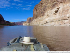 A raft coming out of Cataract Canyon into upper Lake Powell encounters the bathtub ring left by the receding reservoir. As Lake Powell, and Lake Mead, continue to see less and less water, it's prompting water managers, including those at the Colorado River District, to coordinate on ways to send more water downstream. Photo credit: Aspen Journalism/Brent Gardner-Smith