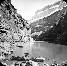 A stopover during Powell's second expedition down the Colorado River. Note Powell's chair at top center boat. Image: USGS