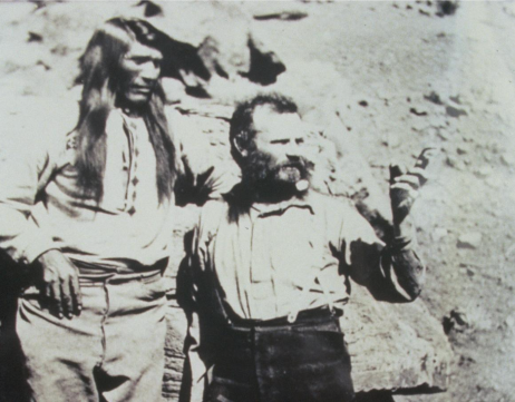 Explorer John Wesley Powell and Paiute Chief Tau-Gu looking over the Virgin River in 1873. Photo credit: NPS