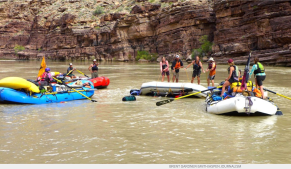 An impromptu workgroup works on a problem on the Colorado River. The group members came together below Doris Rapid in the Grand Canyon after a small raft flipped, and needed to be flipped back over to proceed. The CWCB could be considered to be embarking on a similar exercise in setting up eight workgroups to discuss ways to leave more water in the Colorado River system above Lake Powell. Photo credit: Brent Gardner-Smith/Aspen Journalism