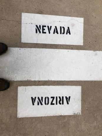 Arizona/Nevada border marker at the base of Hoover Dam.